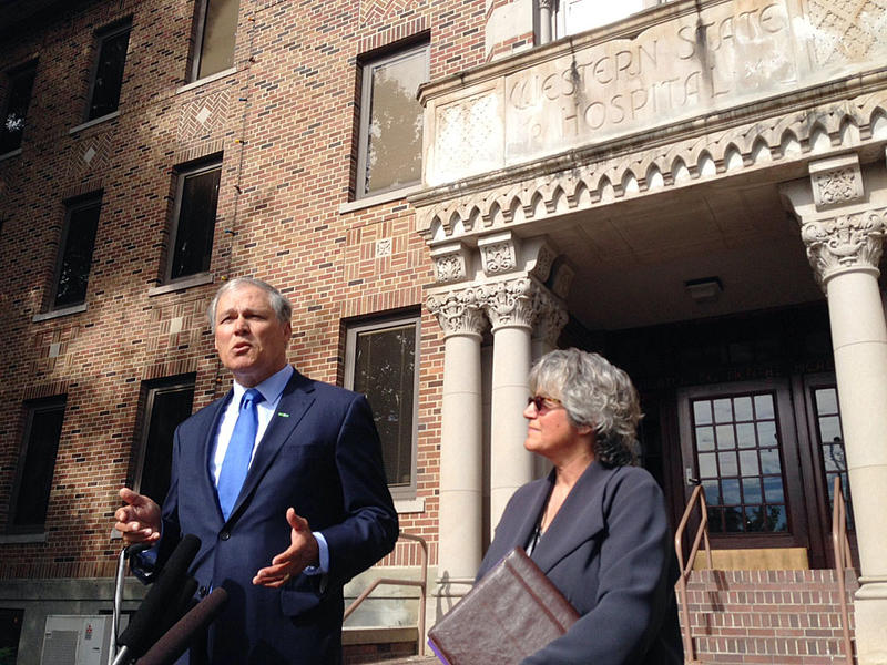 Washington Gov. Jay Inslee, pictured here outside Western State Hospital, is proposing the state explore building a new state hospital.