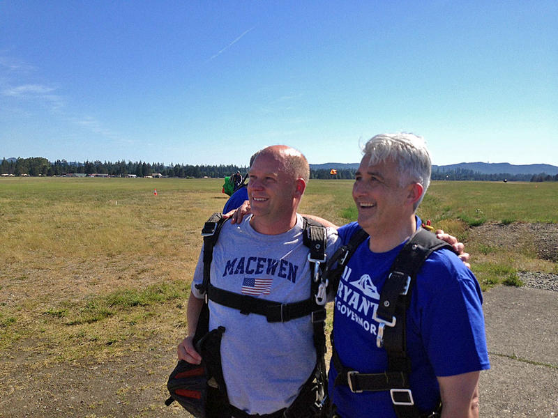 Republicans Drew MacEwen, left, and Bill Bryant are all smiles after skydiving as part of MacEwen's campaign kickoff for state representative. Bryant is running for governor.