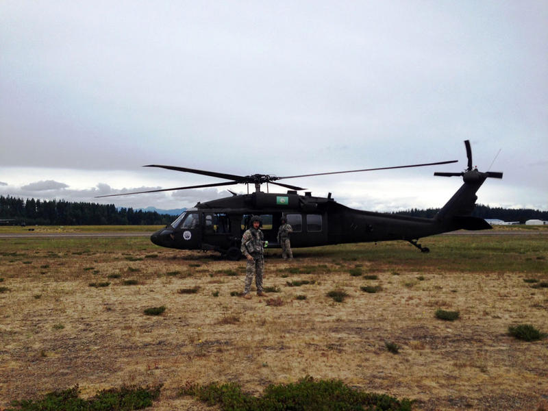A Washington National Guard Black Hawk sits on the ground at the Shelton airport. This airfield could become a critical staging ground for rescue operations in the event of a tsunami on the Washington coast.