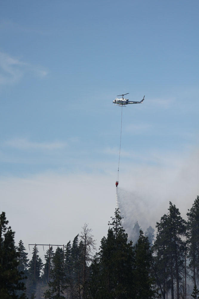 Multiple helicopters were working the 50-acre Hart Road Fire outside Cle Elum, Washingon, on Saturday afternoon.