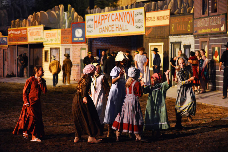 Oregon Trail girls and women practice at a dress rehearsal for this year's 100th performance of Happy Canyon.