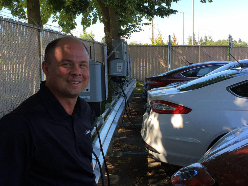 Avista manager of transportation electrification Rendall Farley at his workplace charging station in Spokane.