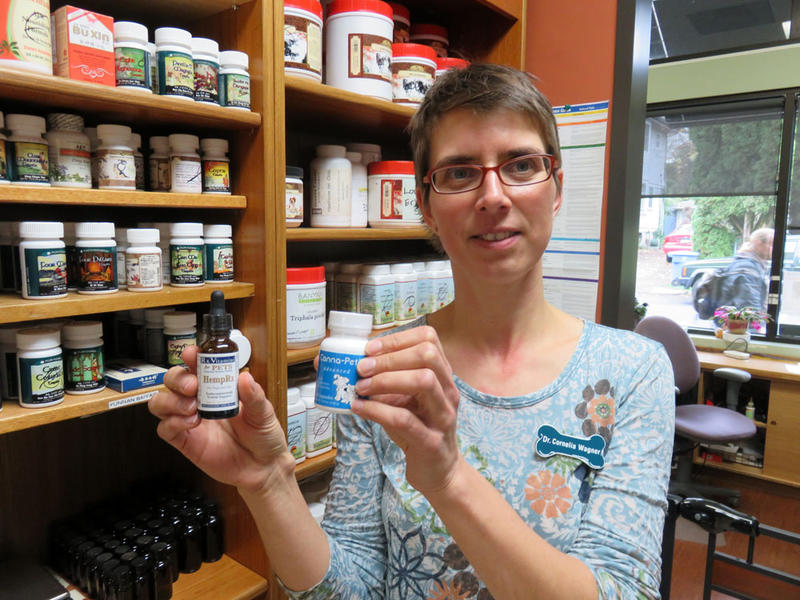 Dr. Cornelia Wagner shows several hemp-based supplements for pets stocked by the Hawthorne Veterinary Clinic.