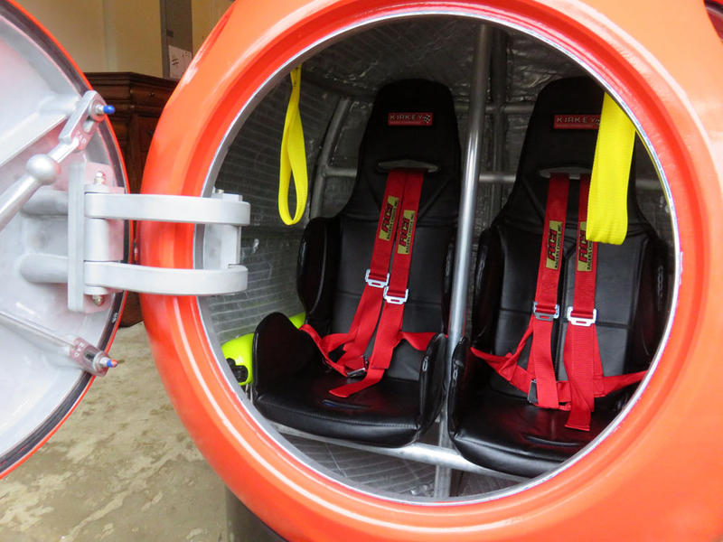 The Survival Capsule's seats have shoulder harnesses and seat belts to buckle in tight.