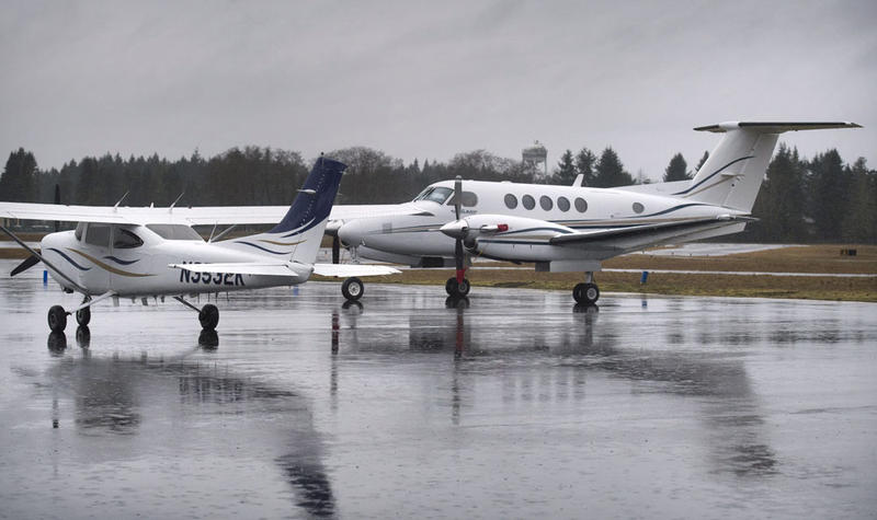 The Beechcraft King Air B200 turboprop aircraft (right) at the Washington State Patrol aviation facility at the Olympia Airport on Wednesday, Feb. 15, 2017.