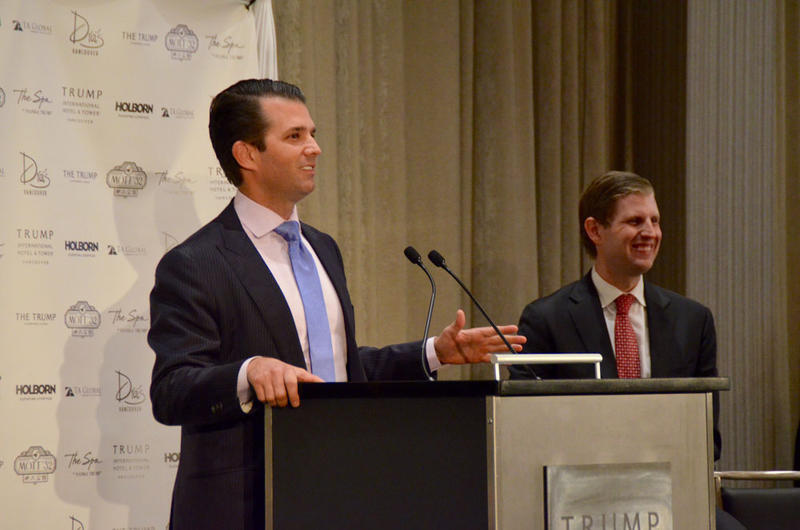 Donald Trump, Jr. speaks at the opening of the Trump International Hotel and Tower Vancouver Tuesday as his brother Eric Trump smiles at their audience.