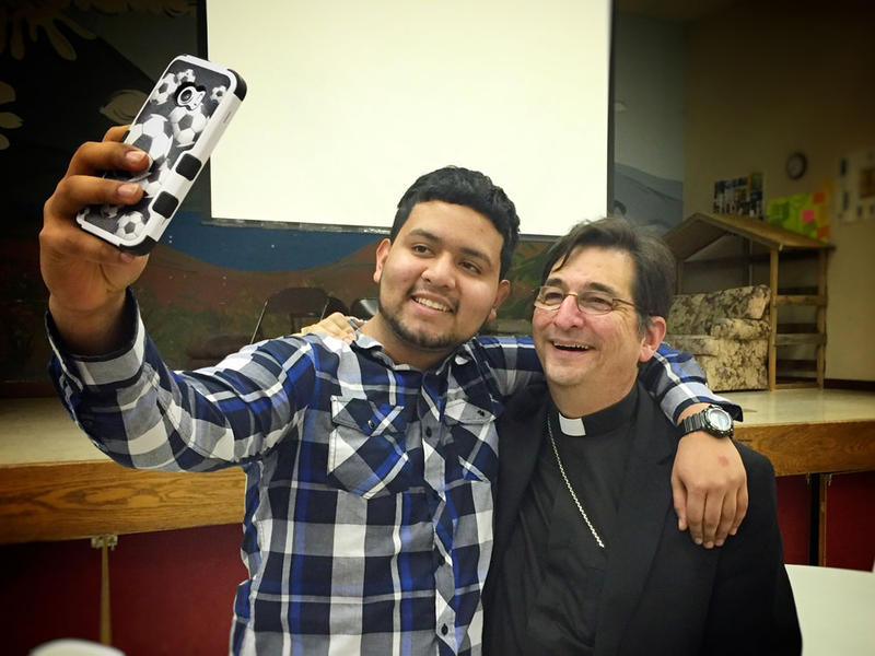 Enrique Acevedo, 18, of Prosser, Washington, takes a selfie with Bishop Joseph Tyson is the head of the Diocese of Yakima after a church program.
