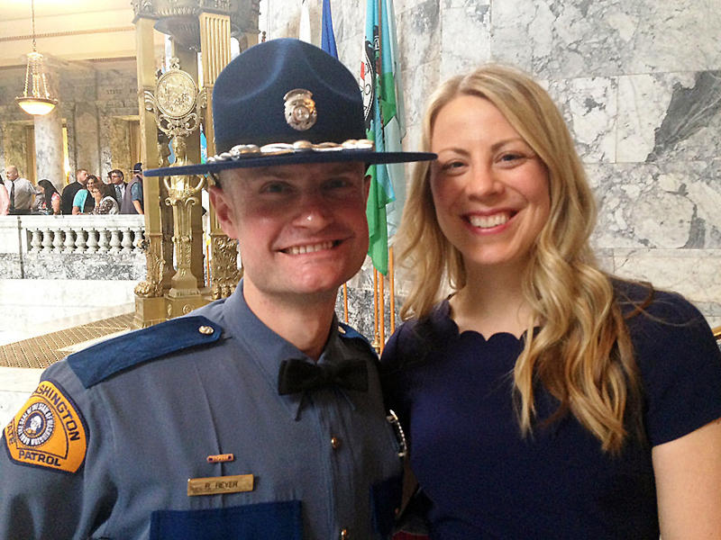 Trooper Robert Reyer poses with his wife Christina at a trooper graduation ceremony at the Washington Capitol. Originally from Austria, Reyer trained to become a doctor before moving to Washington to pursue his dream of working in law enforcement.