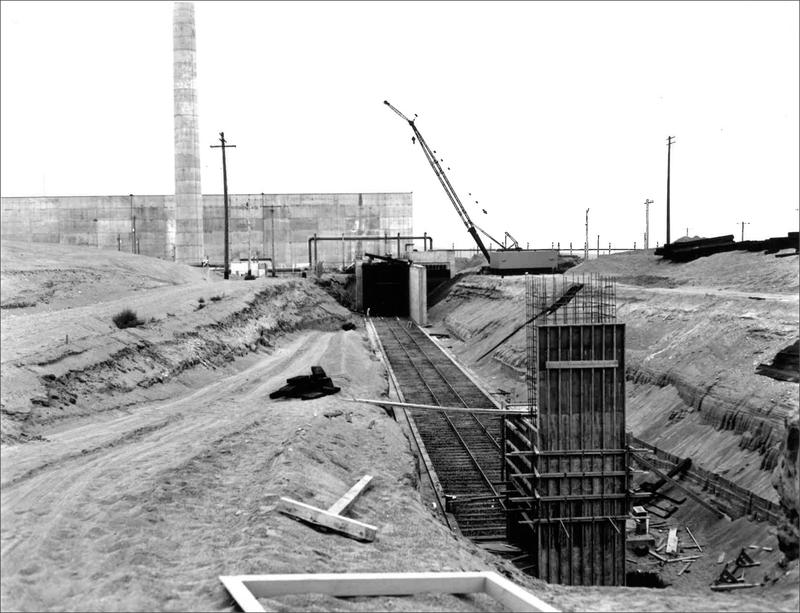 The original railroad tunnel during construction. It was made of treated wood and concrete.