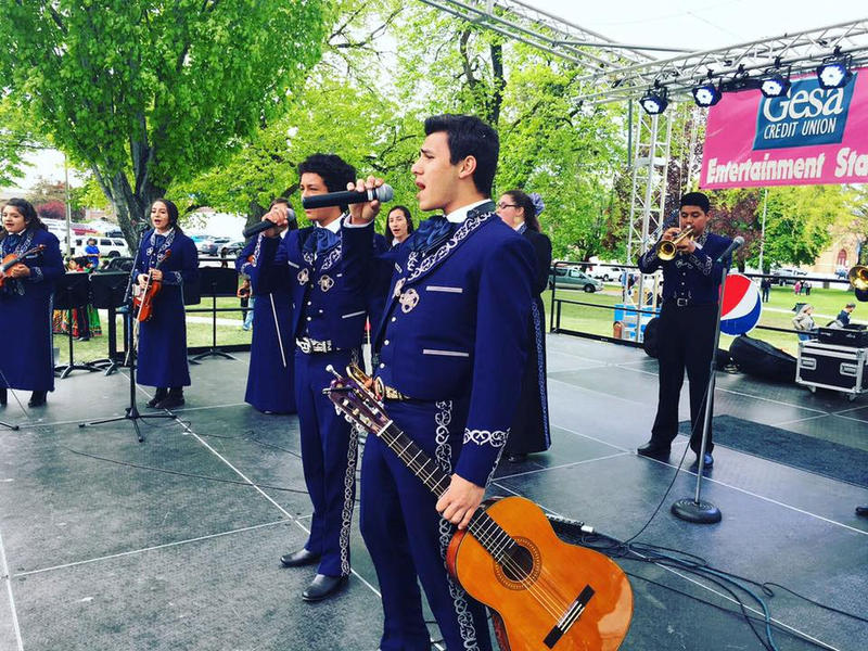 Mariachi Huenachi, part of Wenatchee High School's award winning mariachi program, performs at the Apple Blossom Festival in Wenatchee, Washington.