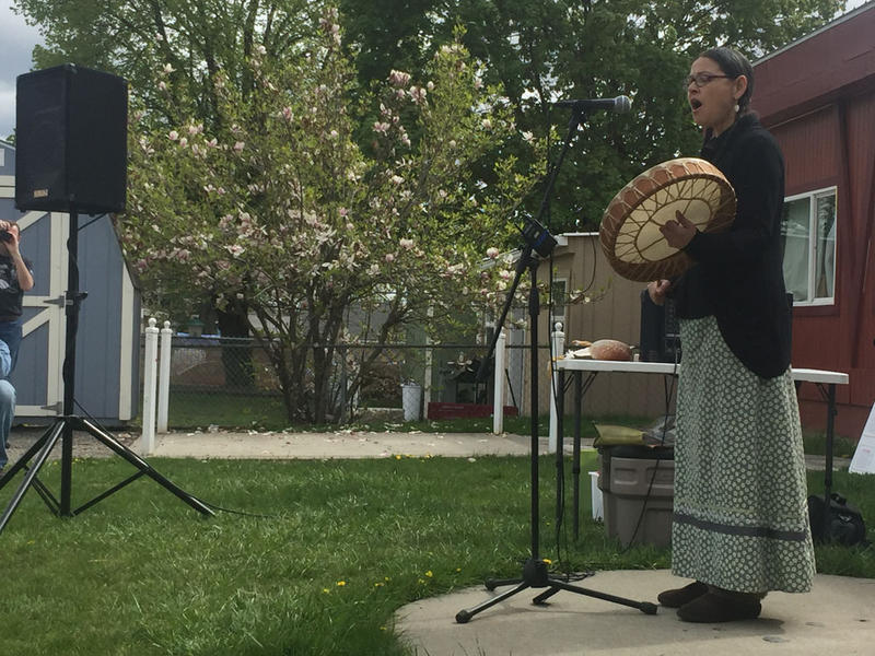 Salish School of Spokane Executive Director LaRae Wiley sings a song as Native elders perform a cleansing ceremony inside the school.