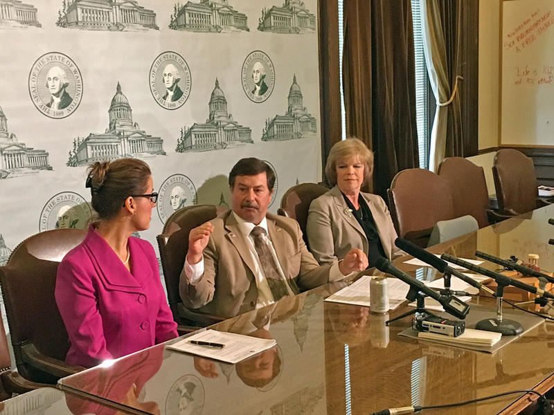 Senate Majority Leader Mark Schoesler, center, gave no indication Tuesday of a change in the form or pace of budget negotiations in the Washington Legislature.