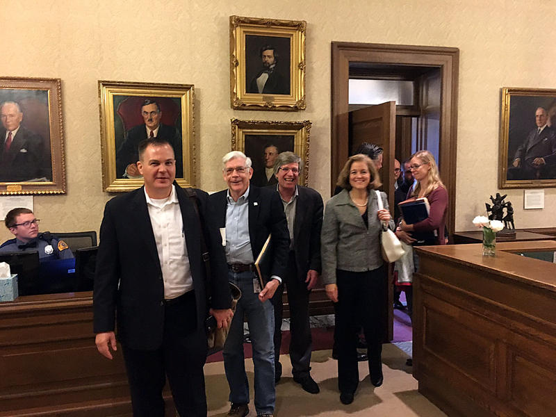 Legislative budget writers emerge smiling from a meeting in the governor's office Thursday. House budget chair Timm Ormsby called the meeting ''very cordial.''