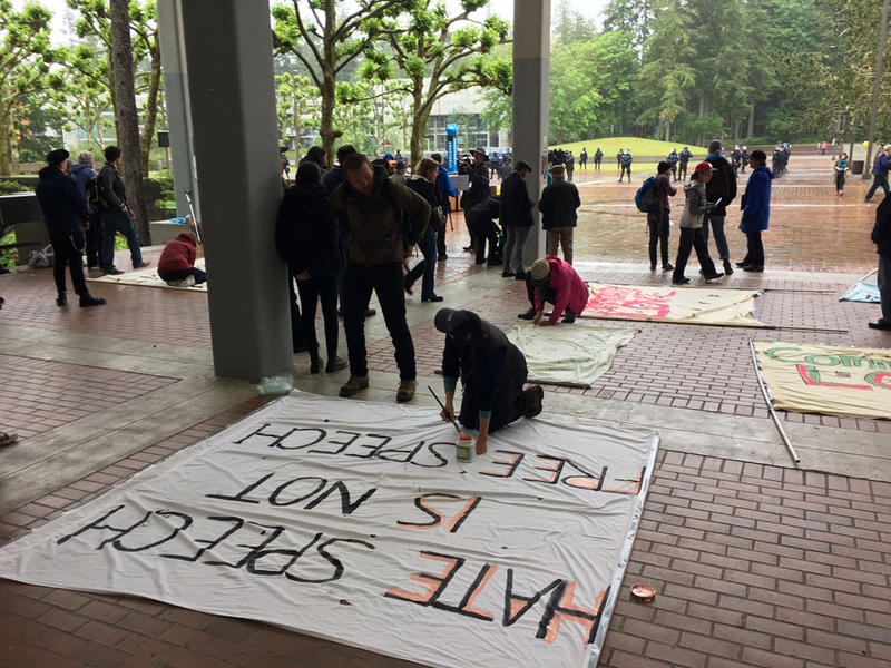 File photo of Evergreen students and supporters making signs before a counter protest on campus last spring.