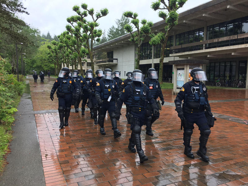 Washington State Troopers arrive at Evergreen State College in Olympia, Washington, Thursday afternoon to keep peace at a ''free speech'' rally held by a pro-Trump group called Patriot Prayer.