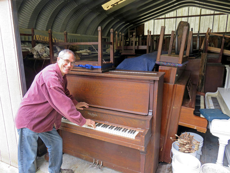Piano tuner Dean Petrich of Freeland, Washington, gives away pianos for the price of delivery to winnow his stash of more than 80 cast-off pianos.