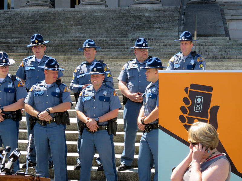 These Washington state troopers, and many more, will issue warnings and write tickets beginning Sunday under the state's toughened distracted driving law.