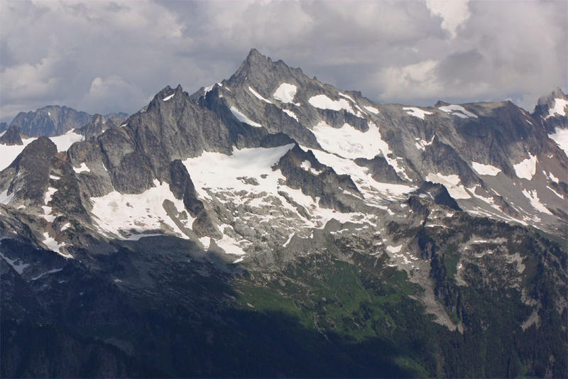 File photo. A climber was killed while descending Forbidden Peak, center, in North Cascades National Park over the weekend.