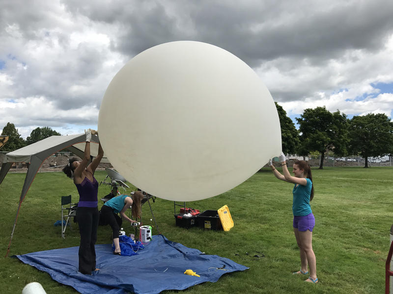 Earlier this summer, PSU students Rihana Mungin (from left), Harmony Ewing and Olea Stevens tested the type of weather balloon they'll use for the NASA-funded Eclipse Ballooning Project on August 21.