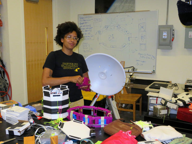 Portland State University engineering student Rihana Mungin works on the payloads that will capture images of the moon's shadow on the earth from high altitude balloons during the August 21 eclipse.