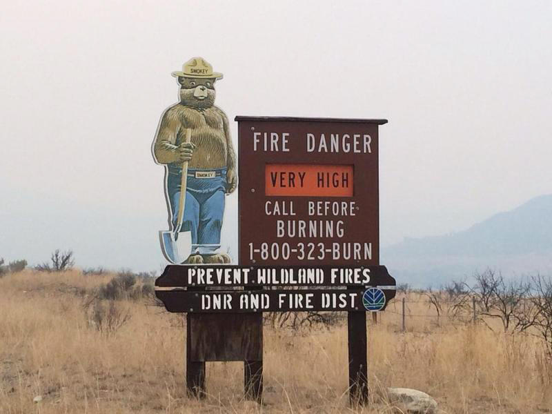 File photo of a fire danger sign between Chelan and Pateros, Washington, during the 2015 Okanogan Complex Fire.