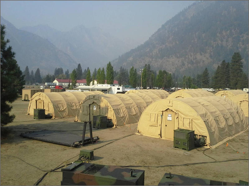 Washington National Guard soldiers set up air-conditioned sleeping tents at the Jolly Mountain fire camp near Cle Elum on Wednesday--like these seen in 2015.