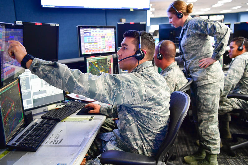 Washington National Guard Capt. Nicholas Rhodes (from left to right), Maj. Matthew Horrocks, Staff Sgt. Kayla Sharpe and Capt. Gregory Firestone remotely coordinating aviation rescues of victims of Hurricane Harvey last week.