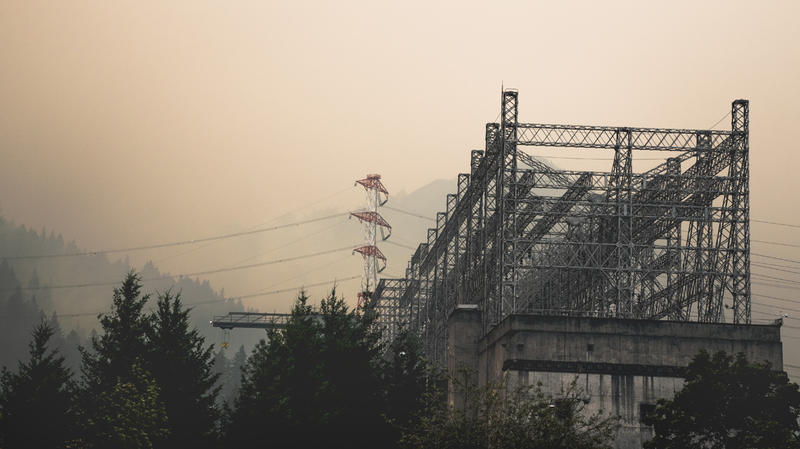 Heavy smoke from the Eagle Creek fire hangs over the Bonneville Dam powerhouse. Mission essential personnel remained at the dam to maintain safe operations and monitor the critical infrastructure.