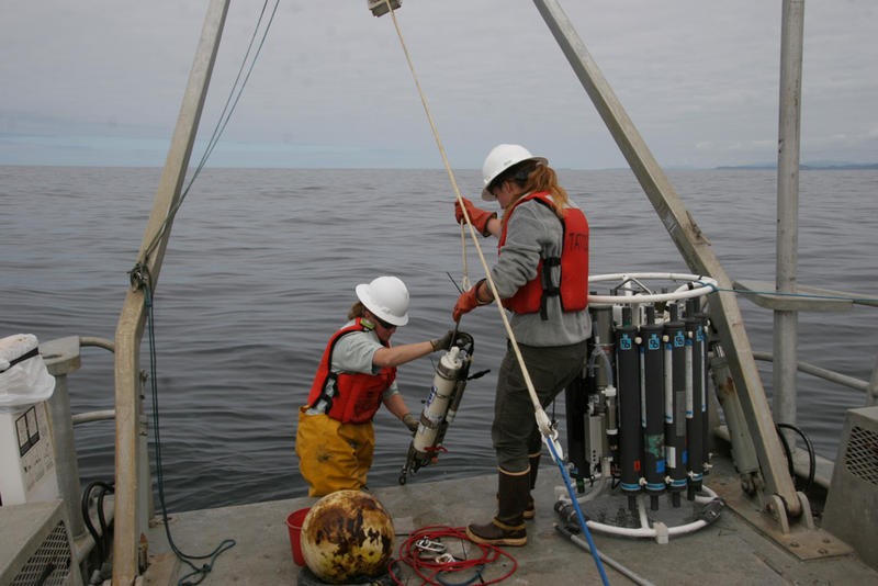Olympic Coast National Marine Sanctuary research team members, Kathy Hough and LTJG Alisha Friel, recover sensors deployed seasonally off the coast of Washington from the research vessel Tatoosh in July 2017.