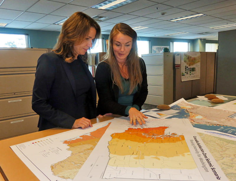 Washington Commissioner of Public Lands Hilary Franz, left, and Chief Hazards Geologist Corina Forson review earthquake fault maps in Olympia.