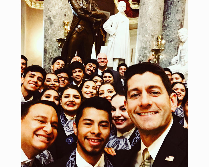 U.S. Speaker of the House Paul Ryan takes a selfie with students from Wenatchee High School who play under Ramon Rivera in the band, Mariachi Huenachi.