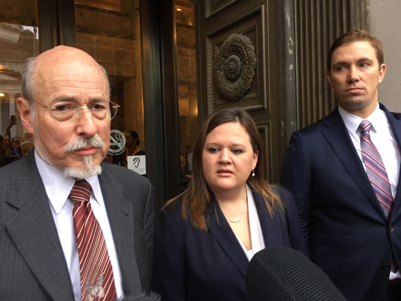 Former prison inmate turned honors law school graduate Tarra Simmons and her attorneys speak with reporters following a Washington Supreme Court hearing.