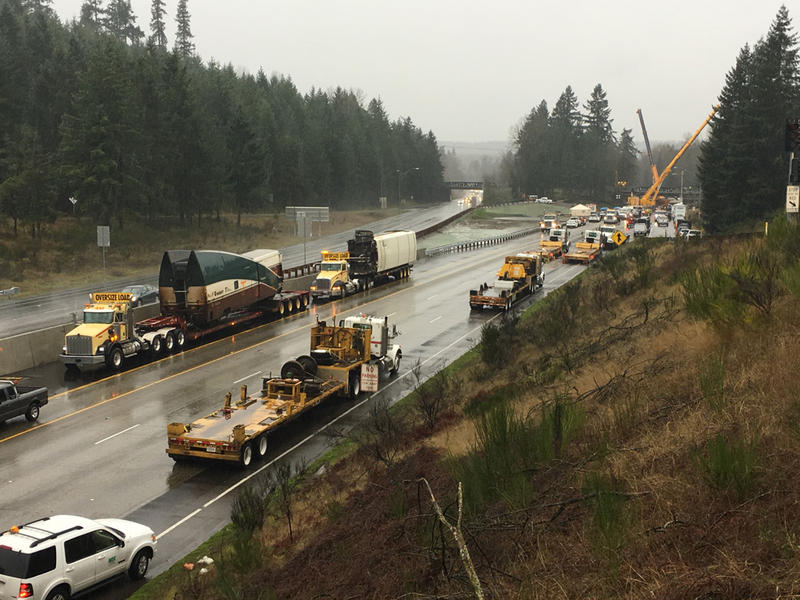 Heavy lift cranes have removed the two Amtrak rail cars that were dangling over the lanes of southbound I-5 from a railroad overpass in DuPont, Washington.