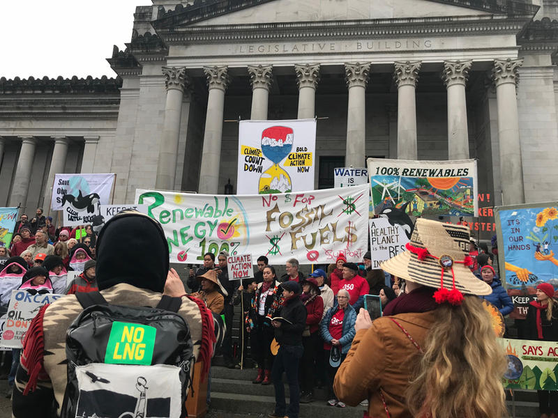 Climate activists rally on the steps of the Washington state Capitol on Monday, the first day of the 2018 legislative session.