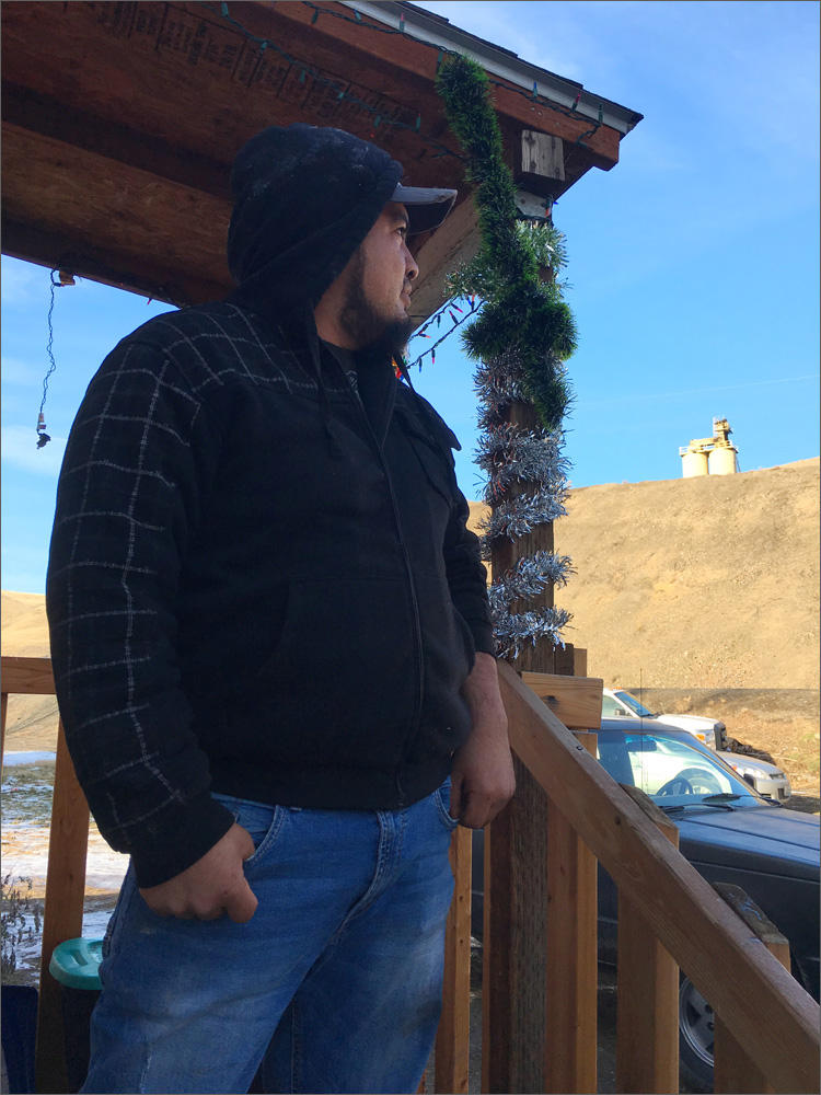 Luis Solorio glances toward the Rattlesnake Ridge landslide from his former home. There's a rental housing crunch across the state, but it is especially true for farmworkers looking for affordable housing in Central Washington.