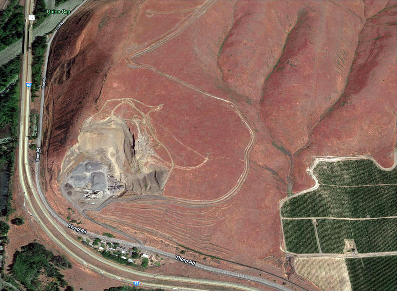 Since this satellite picture was taken, a scary-looking crack has cleaved the hillside above the quarry. Emergency officials are concerned it could turn into a major slide event.