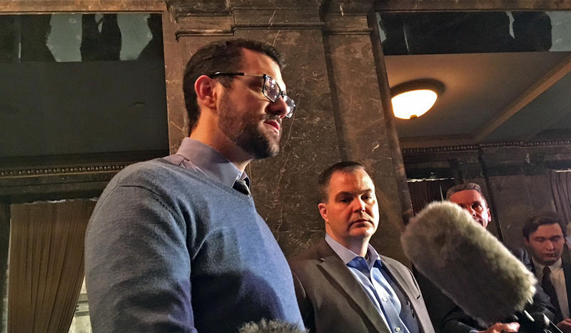Republican state Senators Joe Fain, left, and John Braun speak to reporters the morning after late-night debate on a controversial home health care worker bill.