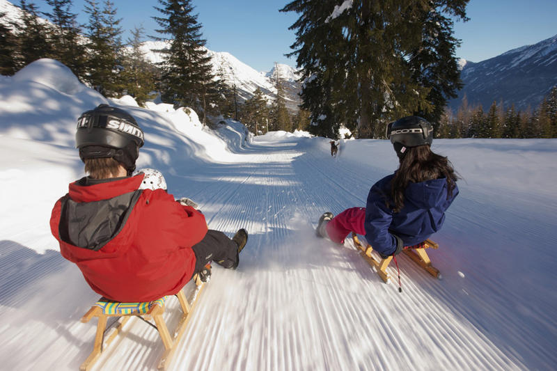 Recreational luge sledding happens on groomed trails rather than an icy chute as used in the Winter Olympics.
