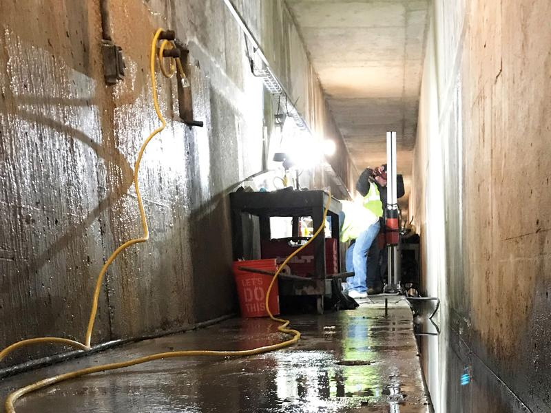 Workers drill core samples in the grout galleries of Priest Rapids Dam in southeast Washington to figure out how extensive leaking is in the structure's spillway.