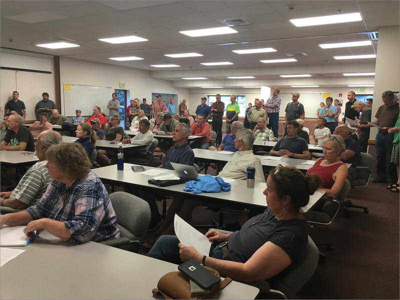 More than 60 residents packed into a stuffy firehall in Leavenworth to learn more about the under-pressure Eightmile Lake Dam upstream from their homes.