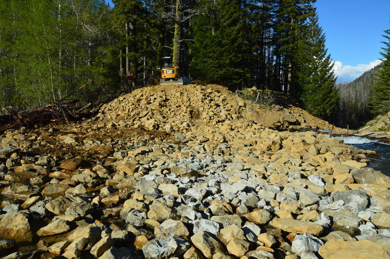 Irrigation District crews have installed a lot of large rock to reinforce the Eightmile Lake Dam over the last week. And the state of Washington has installed new sensors to keep an eye on rainfall and lake levels.