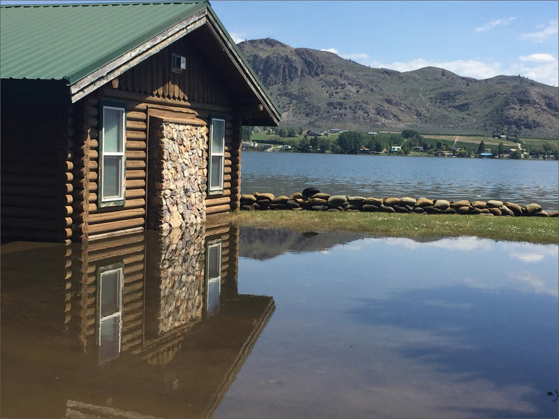 A home along Lake Osoyoos in Oroville, Washington, is already inundated with flood water.  A near record snow year in southern British Columbia combined with temperatures in the upper 80s means flood waters will continue to rise.