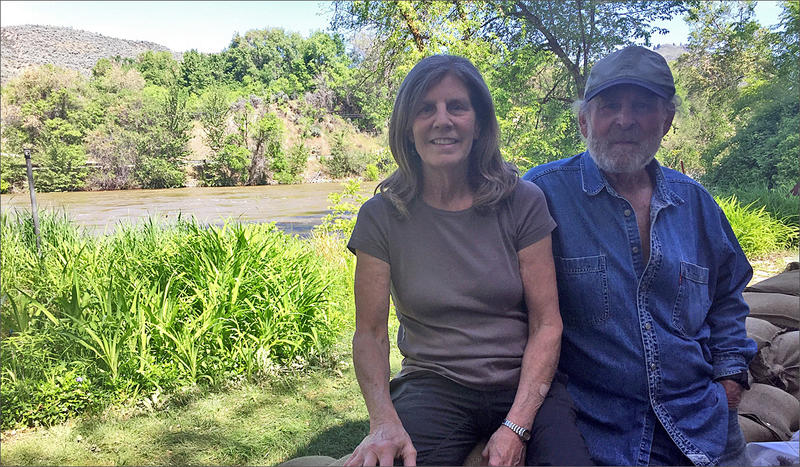 Rose and Andre Corso are trying to make the best of a potentially disastrous situation as they prepare for extreme flooding at their home alongside the Okanogan River in Tonasket, Washington.
