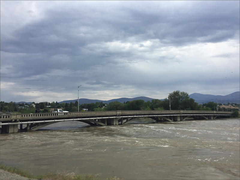 The Okanogan River flows under the downtown Omak Avenue bridge in Omak, Washington. The river is currently above flood stage.