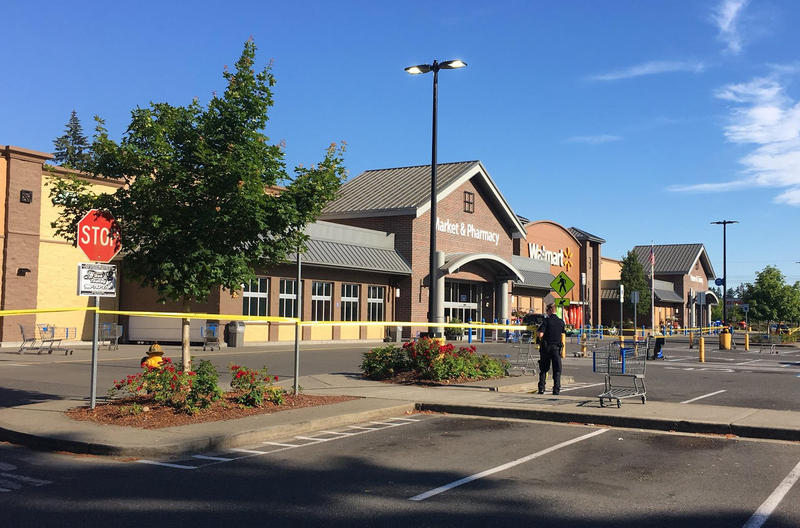 Police block the scene outside a Walmart in Tumwater, Washington, where a gunman shot a driver, then was himself shot to death on Sunday afternoon. The store remained closed on Monday.