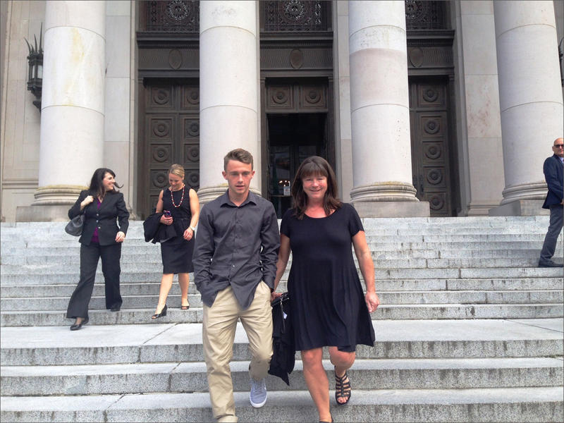 In this 2016 file photo, Stephanie McCleary and her son, Carter, leave the Washington Supreme Court following a hearing in the nearly decade-old school funding lawsuit that bears their name.