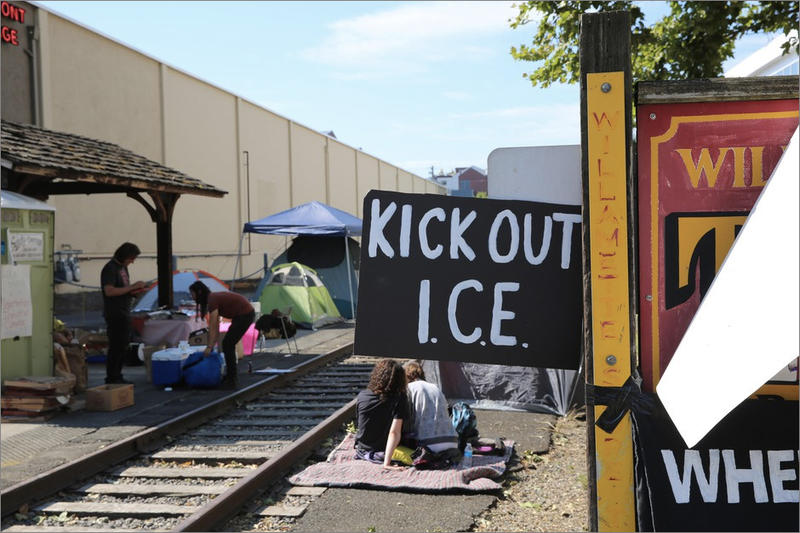 People camp along trolley tracks outside the ICE facility in southwest Portland.