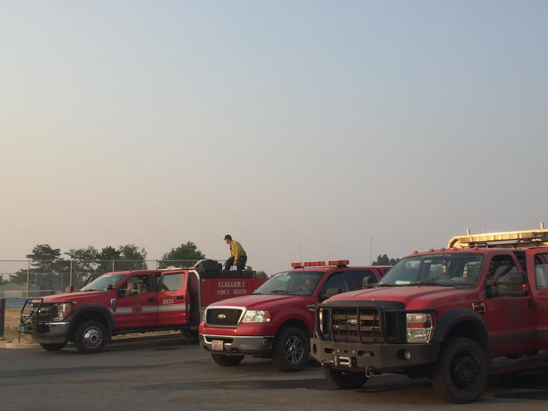 Firefighters load their trucks with water for a day on the Silver Lake fire outside Spokane.
