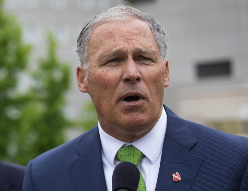 Gov. Jay Inslee, shown here at the Federal Detention Center in SeaTac in June, has traveled on behalf of the Democratic Governors Association more than a dozen times in 2018.
