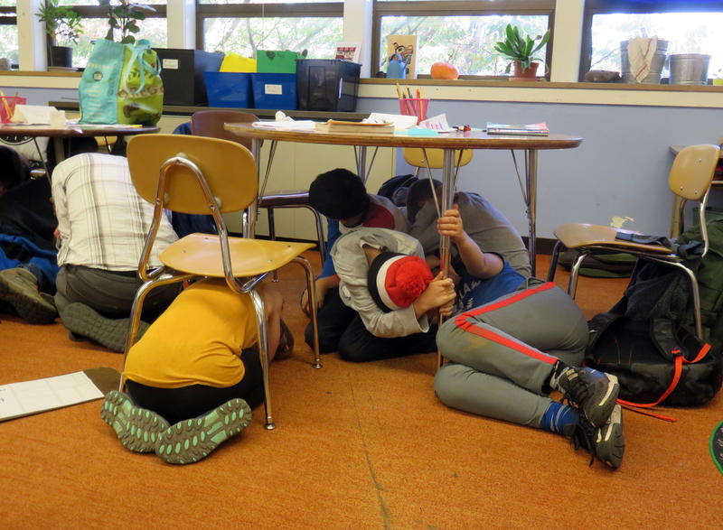 Drop, cover and hold was just the beginning for a drill at Sunnyside Environmental K-8 School last Wednesday.